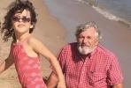 Chris-Bryan-seashore w/ granddaughter