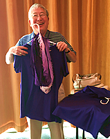 Halley Moriyama holding 50th Reunion parade t-shirt and scarf