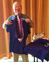 Halley Moriyama holding 50th Reunion parade t-shirt and scarf